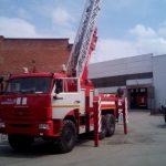 Пожарная автоцистерна с лестницей